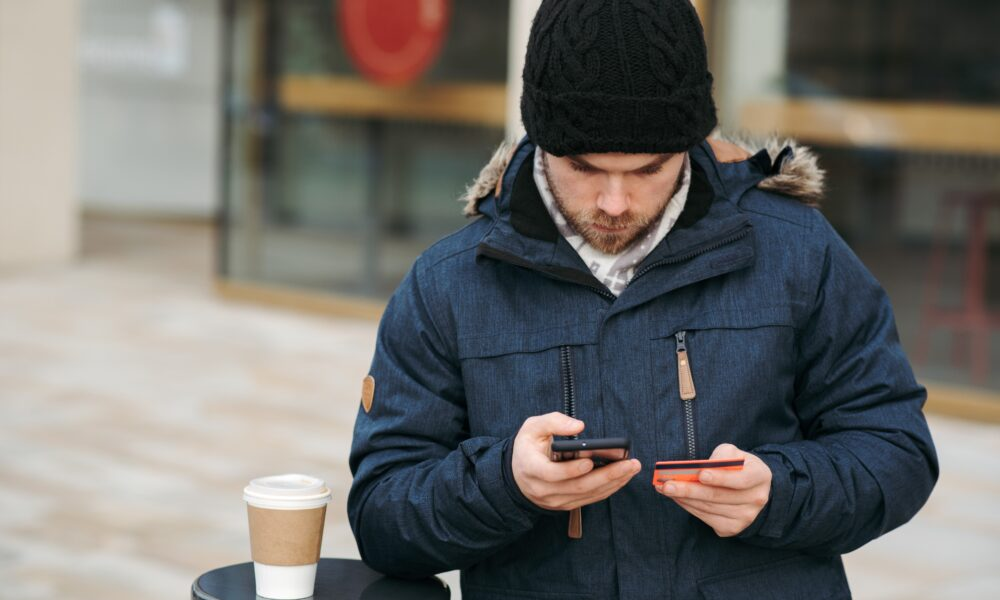 man in a winter jacket on a phone